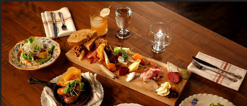 A selection of food mains and appetizers available at Den & Meadow restaurant and bar, Banff, Alberta.